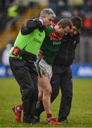 28 January 2018; Colm Boyle of Mayo is helped from the field following an injury during the Allianz Football League Division 1 Round 1 match between Monaghan and Mayo at St Tiernach's Park in Clones, County Monaghan. Photo by Seb Daly/Sportsfile