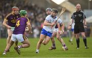 28 January 2018; Jamie Barron of Waterford in action against Diarmuid O'Keeffe, Ahaun Murphy and Kevin Foley of Wexford during the Allianz Hurling League Division 1A Round 1 match between Waterford and Wexford at Walsh Park in Waterford.  Photo by Matt Browne/Sportsfile