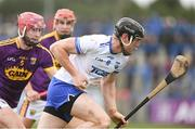 28 January 2018; Kevin Moran of Waterford in action against Paudie Foley of Wexford during the Allianz Hurling League Division 1A Round 1 match between Waterford and Wexford at Walsh Park in Waterford.  Photo by Matt Browne/Sportsfile