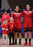 28 January 2018; Team mascots Heidi, left, and Zara Murphy with team captain Kellie Cahalane and Amanda O'Regan of Fr Mathews during the national anthem ahead of the Hula Hoops Senior Women's Cup Final match between Fr Mathews and Meteors at the National Basketball Arena in Tallaght, Dublin. Photo by Brendan Moran/Sportsfile