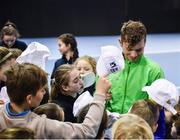 29 January 2018; Irish Davis Cup team member Simon Carr signs caps for young players from the David Lloyd Riverview tennis club following a team practice session ahead of their Davis Cup Group 2 tie against Denmark on Saturday 3rd of February. David Lloyd Riverview, in Clonskeagh, Dublin. Photo by Seb Daly/Sportsfile