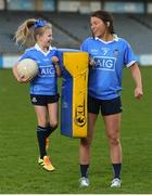 30 January 2018; Dublin footballer Leah Caffrey with young Dub, Kyah O'Reilly, age 8, in Parnell Park to kick off the 2018 Dublin GAA Season with team sponsor's AIG Insurance. To celebrate the new year, AIG revealed details of their latest car insurance deal, offering 20% off car insurance to new customers. For more info call 1890 50 27 27 or log on to www.aig.ie/dubs. Parnell Park, Dublin. Photo by David Fitzgerald/Sportsfile