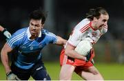 3 February 2018; Conall McCann of Tyrone in action against Michael Darragh Macauley of Dublin during the Allianz Football League Division 1 Round 2 match between Tyrone and Dublin at Healy Park in Omagh, County Tyrone. Photo by Oliver McVeigh/Sportsfile