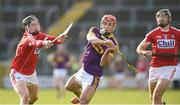 4 February 2018; Lee Chin of Wexford in action against Darragh Fitzgibbon and Christopher Joyce of Cork during the Allianz Hurling League Division 1A Round 2 match between Wexford and Cork at Innovate Wexford Park, in Wexford. Photo by Matt Browne/Sportsfile
