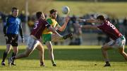 4 February 2018; Odhran MacNiallais of Donegal in action against Patrick Sweeney and Paul Conroy of Galway  during the Allianz Football League Division 1 Round 2 match between Donegal and Galway at O'Donnell Park, in Letterkenny, Donegal. Photo by Oliver McVeigh/Sportsfile