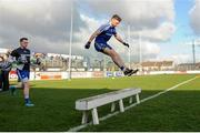4 February 2018; Fintan Kelly of Monaghan jumps over the team bench as he leads team-mates to the field ahead of the Allianz Football League Division 1 Round 2 match between Kildare and Monaghan at St Conleth's Park, in Newbridge, Kildare. Photo by Barry Cregg/Sportsfile