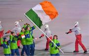 9 February 2018; Flagbearer Seamus O'Connor of Ireland leads his team during the parade of nations at the opening ceremony of the Winter Olympics at the PyeongChang Olympic Stadium in Pyeongchang-gun, South Korea. Photo by Ramsey Cardy/Sportsfile Photo by Ramsey Cardy/Sportsfile