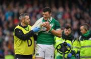 10 February 2018; Robbie Henshaw of Ireland grimaces with a shoulder injury as he leaves the pitch with Ireland team doctor Ciaran Cosgrave during the Six Nations Rugby Championship match between Ireland and Italy at the Aviva Stadium in Dublin. Photo by Brendan Moran/Sportsfile