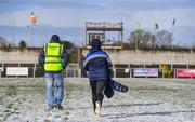 11 February 2018; Grattan Park steward Michael Kindlon and his son Michael, from Inniskeen, make their way across the pitch in Grattan Park after the Allianz Football League Division 1 Round 3 match between Monaghan and Kerry at Páirc Grattan in Inniskeen, Monaghan, was called off. Photo by Brendan Moran/Sportsfile