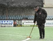 11 February 2018; Groundsman Harry Taaffe clears snow from the pitch prior to the President's Cup match between Dundalk and Cork City at Oriel Park in Dundalk, Co Louth. Photo by Seb Daly/Sportsfile