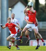 11 February 2018; Tommy Durnin of Louth in action against Ian Maguire of Cork during the Allianz Football League Division 2 Round 3 match between Cork and Louth at Páirc Ui Rinn in Cork. Photo by Eóin Noonan/Sportsfile