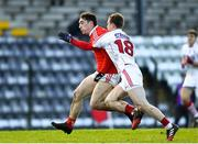 11 February 2018; Derek Maguire of Louth in action against Matthew Taylor of Cork during the Allianz Football League Division 2 Round 3 match between Cork and Louth at Páirc Ui Rinn in Cork. Photo by Eóin Noonan/Sportsfile