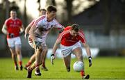 11 February 2018; Gerald McSorley in action against Sam Ryan of Cork during the Allianz Football League Division 2 Round 3 match between Cork and Louth at Páirc Ui Rinn in Cork. Photo by Eóin Noonan/Sportsfile