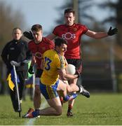 11 February 2018; Diarmuid Murtagh of Roscommon in action against Colm Flanagan, left, and Niall Donnelly of Down during the Allianz Football League Division 2 Round 3 match between Roscommon and Down at Dr. Hyde Park in Roscommon. Photo by Daire Brennan/Sportsfile
