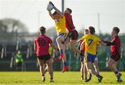 11 February 2018; Enda Smith of Roscommon in action against Caolán Mooney of Down during the Allianz Football League Division 2 Round 3 match between Roscommon and Down at Dr. Hyde Park in Roscommon. Photo by Daire Brennan/Sportsfile