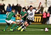 11 February 2018; Robbie Benson of Dundalk in action against Conor McCormack, left, and Barry McNamee of Cork City during the President's Cup match between Dundalk and Cork City at Oriel Park in Dundalk, Co Louth. Photo by Seb Daly/Sportsfile