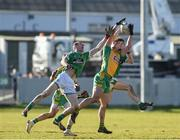 17 February 2018; Daithi Burke of Corofin in action against Ronan Sweeney, left, and Sean Healy of Moorefield during the AIB GAA Football All-Ireland Senior Club Championship Semi-Final match between Corofin and Moorefield at O'Connor Park in Tullamore, Offaly. Photo by Matt Browne/Sportsfile