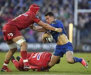 17 February 2018; Noel Reid of Leinster is tackled by Josh Macleod, left, and Phil Price of Scarlets during the Guinness PRO14 Round 15 match between Leinster and Scarlets at the RDS Arena in Dublin. Photo by Brendan Moran/Sportsfile