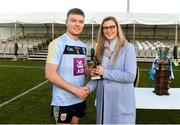 17 February 2018; Pictured is Lynne D'Arcy, Sponsorship, Electric Ireland, proud sponsor of the Electric Ireland GAA Higher Education Championships, presenting Conor McCarthy from University College Dublin with the Man of the Match award for his outstanding performance in the Electric Ireland Sigerson Cup Final, between University College Dublin and NUI Galway at Santry Avenue in Dublin. The unique quality of the Electric Ireland Higher Education Championships sees these players putting their intercounty and club rivalries aside to strive to achieve Electric Ireland Sigerson Cup glory. Electric Ireland has been shining a light on these First Class Rivals as proud sponsor of the college level competitions for the next four years. Photo by Daire Brennan/Sportsfile
