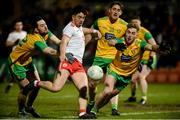 17 February 2018; Ronan O'Neill of Tyrone in action against Mark McHugh and Stephen McMenamin of Donegal during the Bank of Ireland Dr. McKenna Cup Final match between Tyrone and Donegal at the Athletic Grounds in Armagh. Photo by Oliver McVeigh/Sportsfile