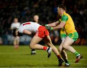 17 February 2018; Ronan McHugh of Tyrone in action against Eamonn Doherty of Donegal during the Bank of Ireland Dr. McKenna Cup Final match between Tyrone and Donegal at the Athletic Grounds in Armagh. Photo by Oliver McVeigh/Sportsfile