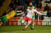 17 February 2018; Michael Cassidy of Tyrone in action against Conor Morrison of Donegal during the Bank of Ireland Dr. McKenna Cup Final match between Tyrone and Donegal at the Athletic Grounds in Armagh. Photo by Oliver McVeigh/Sportsfile