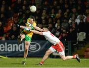 17 February 2018; Michael Murphy of Donegal scoring a point despite the attempted block of Pádraig Hampsey of Tyrone during the Bank of Ireland Dr. McKenna Cup Final match between Tyrone and Donegal at the Athletic Grounds in Armagh. Photo by Oliver McVeigh/Sportsfile