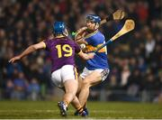 17 February 2018; Jason Forde of Tipperary shoots to score his side's second goal despite the attention of Conor Firman of Wexford during the Allianz Hurling League Division 1A Round 3 match between Tipperary and Wexford at Semple Stadium in Thurles, Tipperary. Photo by Stephen McCarthy/Sportsfile