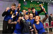 17 February 2018; Noah Murphy, age 5, lifts the cup with the Spa team, Erin Holland, Meghann Cronin,Siona Moynihan, Orlaith Spillane, Liam Spillane, Gary O'Sullivan, Cian O'Sullivan and Eoghan Mulvanney from Kerry, after winning the Set Dancing category during the All-Ireland Scór na nÓg Final 2018 at the Knocknarea Arena in Sligo IT, Sligo. Photo by Eóin Noonan/Sportsfile