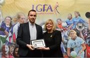 17 February 2018; The Ladies Gaelic Football Association has announced details of the inaugural LGFA Volunteer of the Year awards. Administrators, coaches and media were among those honoured across seven categories, and the awards were presented at Croke Park on Saturday, February 17. Kieran McCarthy, The Southern Star Newspaper, Co Cork, is presented with the Local Journalist of the Year Award by Ladies Gaelic Football Association President Marie Hickey. Croke Park, Dublin. Photo by Piaras Ó Mídheach/Sportsfile