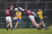 18 February 2018; Cathal Cregg of Roscommon kicks under pressure from Johnny Duane, left, and Tomas Flynn of Galway during the Connacht FBD League Final match between Roscommon and Galway at Dr Hyde Park in Roscommon. Photo by Harry Murphy/Sportsfile