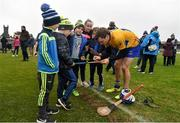 18 February 2018; Shane O'Donnell of Clare signs a hurley for a young supporter following the Allianz Hurling League Division 1A Round 3 match between Clare and Cork at Cusack Park in Ennis, Clare. Photo by Seb Daly/Sportsfile