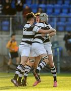 19 February 2018; Matthew Grogan of Belvedere College, right, celebrates with team-mates Cian Scott and Cailean Mulvaney after scoring his side's third try during the Bank of Ireland Leinster Schools Senior Cup Round 2 match between Belvedere College and Newbridge College at Donnybrook Stadium in Dublin. Photo by James Doherty/Sportsfile