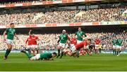 24 February 2018; Gareth Davies of Wales scores his side's first try despite the tackle from James Ryan of Ireland during the NatWest Six Nations Rugby Championship match between Ireland and Wales at the Aviva Stadium in Lansdowne Road, Dublin. Photo by David Fitzgerald/Sportsfile