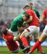 24 February 2018; Chris Farrell of Ireland is tackled by Hadleigh Parkes, left, and Scott Williams of Walesduring the NatWest Six Nations Rugby Championship match between Ireland and Wales at the Aviva Stadium in Dublin. Photo by Ramsey Cardy/Sportsfile