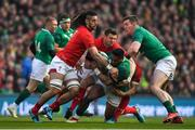 24 February 2018; Bundee Aki of Ireland, supported by team-mate Chris Farrell, is tackled by Josh Navidi and Dan Biggar of Wales during the NatWest Six Nations Rugby Championship match between Ireland and Wales at the Aviva Stadium in Lansdowne Road, Dublin. Photo by Brendan Moran/Sportsfile