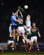 24 February 2018; Brian Howard of Dublin scores his side's second goal despite the efforts of goalkeeper Rob Hennelly and Kevin McLoughlin of Mayo during the Allianz Football League Division 1 Round 4 match between Mayo and Dublin at Elverys MacHale Park in Castlebar, Co Mayo. Photo by Stephen McCarthy/Sportsfile