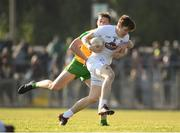 25 February 2018; Kevin Feely of Kildare in action against Hugh McFadden of Donegal during the Allianz Football League Division 1 Round 4 match between Donegal and Kildare at Fr Tierney Park in Ballyshannon, Co Donegal. Photo by Stephen McCarthy/Sportsfile