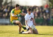 25 February 2018; Cian O'Donoghue of Kildare in action against Jamie Brennan of Donegal during the Allianz Football League Division 1 Round 4 match between Donegal and Kildare at Fr Tierney Park in Ballyshannon, Co Donegal. Photo by Stephen McCarthy/Sportsfile