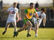 25 February 2018; Neil McGee of Donegal in action against Chris Healy, right, and Daniel Flynn of Kildare during the Allianz Football League Division 1 Round 4 match between Donegal and Kildare at Fr Tierney Park in Ballyshannon, Co Donegal. Photo by Stephen McCarthy/Sportsfile