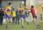 25 February 2018; Gary Brennan of Clare in action against Darren O'Hagan of Down during the Allianz Football League Division 2 Round 4 match between Down and Clare at Páirc Esler, Newry, in Down. Photo by Oliver McVeigh/Sportsfile