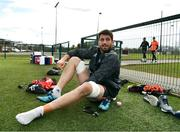 26 February 2018; Jean Kleyn puts on his boots prior to Munster Rugby squad training at the University of Limerick in Limerick. Photo by Diarmuid Greene/Sportsfile