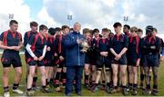 27 February 2018; Senior Vice President of Leinster Rugby Lorcan Balfe presents the trophy to Chris Gilmer of Wesley College after the Bank of Ireland Leinster Schools Fr. Godfrey Cup Final match between Kilkenny College and Wesley College at Naas RFC in Kildare. Photo by Harry Murphy/Sportsfile