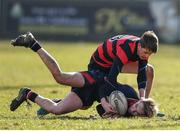 27 February 2018; Adam Walker of Wesley College is tackled by Stephen Young of Kilkenny College during the Bank of Ireland Leinster Schools Fr. Godfrey Cup Final match between Kilkenny College and Wesley College at Naas RFC in Kildare. Photo by Harry Murphy/Sportsfile