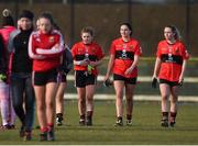 10 March 2018; UCC players, from left, Libby Coppinger, Geraldine Power, and Megan Dunford leave the field after the Gourmet Food Parlour HEC O'Connor Cup semi-final match between University of Limerick and University College Cork at IT Blanchardstown in Blanchardstown, Dublin. Photo by Piaras Ó Mídheach/Sportsfile