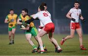 10 March 2018; Mark McHugh of Donegal in action against Colm Cavanagh and Pádraig Hampsey of Tyrone match between Tyrone and Donegal at Healy Park in Omagh, Co Tyrone. Photo by Oliver McVeigh/Sportsfile