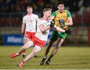 10 March 2018; Hugh Pat McGeary of Tyrone in action against Odhran MacNiallais of Donegal during the Allianz Football League Division 1 Round 5 match between Tyrone and Donegal at Healy Park in Omagh, Co Tyrone. Photo by Oliver McVeigh/Sportsfile