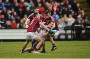 11 March 2018; Jack McCarron of Monaghan in action against, from left, Cathal Sweeney, Eamonn Brannigan, and Paul Conroy of Galway during the Allianz Football League Division 1 Round 5 match between Galway and Monaghan at Pearse Stadium in Galway. Photo by Aaron Greene/Sportsfile