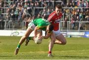 11 March 2018: Donal Lenihan of Meath in action against Kevin Flahive of Cork  during the Allianz Football League Division 2 Round 5 match between Meath and Cork at Páirc Tailteann in Navan, Co Meath. Photo by Oliver McVeigh/Sportsfile