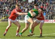 11 March 2018: Donal Lenihan of Meath in action against Sean White and Kevin Flahive of Cork during the Allianz Football League Division 2 Round 5 match between Meath and Cork at Páirc Tailteann in Navan, Co Meath. Photo by Oliver McVeigh/Sportsfile